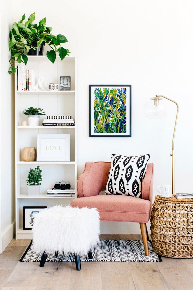 How to style bookshelves, pink chair, greenery on shelves
